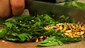 Chopping basil and pine nuts (for pesto)