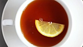 A cup of tea with lemon (from above)