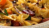 Farfalle with chorizo and artichokes