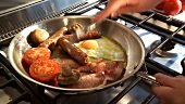 English breakfast: bacon, egg, sausage etc. in frying pan