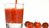 Pouring tomato juice into a chilled glass