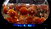 Cooking tomatoes in hot water