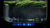 Cooking pea pods in hot water