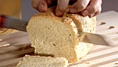 Slicing a loaf of bread