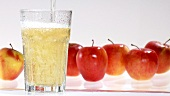 Pouring apple juice into a chilled glass