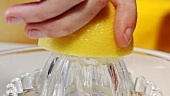 Squeezing a lemon (close-up)
