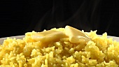 Yellow rice with knobs of butter