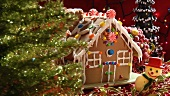Gingerbread house behind Christmas tree