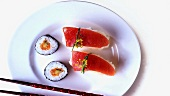Maki sushi and nigiri sushi on plate