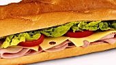 Ham, cheese, tomato and lettuce in baguette