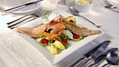 Fish platter with salad garnish