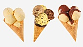 Three cones of different flavoured ice cream