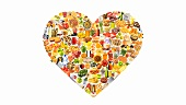 Many different foods and dishes forming a heart