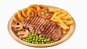 Grilled steak with chips, peas, mushrooms and onion rings