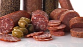 Various types of salami and green olives