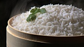 Steamed basmati rice in a bamboo basket