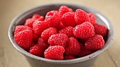Fresh raspberries in a dish