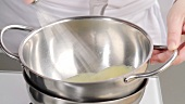 Eggs being beaten in a bain marie