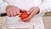 Skinning a blanched tomato