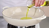 Pouring oil into a deep frying pan