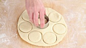 Circles being cut out of pastry
