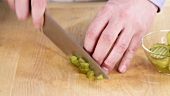 Gherkins being chopped