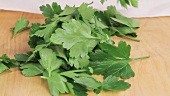 Parsley leaves being torn off stems