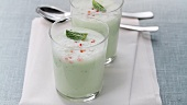 Cold cucumber and yogurt soup in two glasses