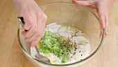 Ingredients for tzatziki being mixed together