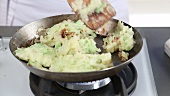 Bubble & Squeak being made: Mashed potatoes and cabbage mixed being fried
