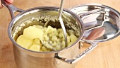 Potatoes being mashed