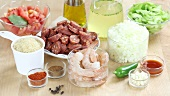 Ingredients for jambalaya (Creole rice stew with prawns and sausages)