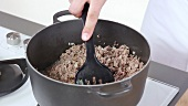 Onions and minced meat being fried