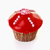 Muffin with red icing and sugar flower