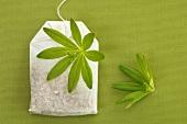 Tea bag and woodruff leaf