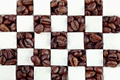 Sugar cubes and coffee beans, clos