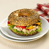 Poppy and sesame seed bagel filled with tuna salad