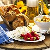Hearty snack: radishes, obatzda, bread rolls & beer (Bavaria)