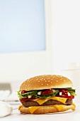 Cheeseburger beside computer