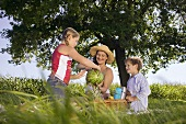 Mother with daughter and son at picnic