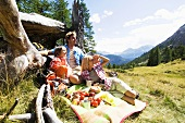 Austria, Salzburger land, parents and son (8-9) having picnic