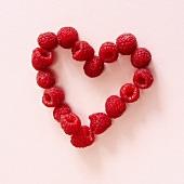 Fresh raspberries forming a heart