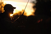 Fly fisherman at dusk