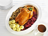 Stuffed roast goose with red cabbage & dumplings (Pomeranian style)