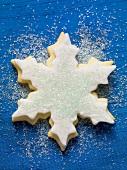 Snowflake biscuit with blue sugar