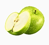 Green apple, whole and half, with drops of water