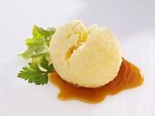 Potato dumpling with gravy and parsley