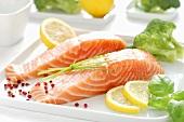 Raw salmon fillet, lemon slices, basil and broccoli