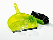 Dustpan and brush with broken glass