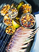 Grilled lemon halves and ribs of mutton